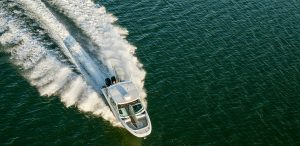 Boston Whaler cruising on the water overhead aerial shot